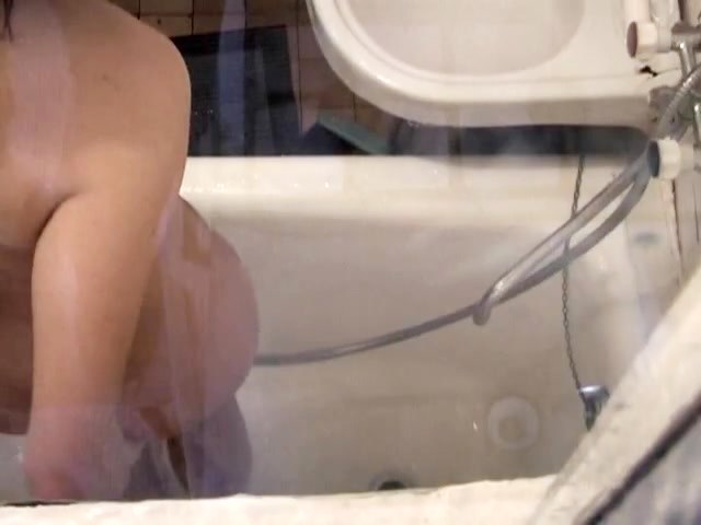 Naked and wet blonde spied in the shower