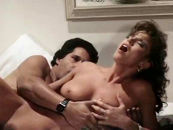 Tracey Adams, Herschel Savage in vintage porn video of a sexy couple fucking